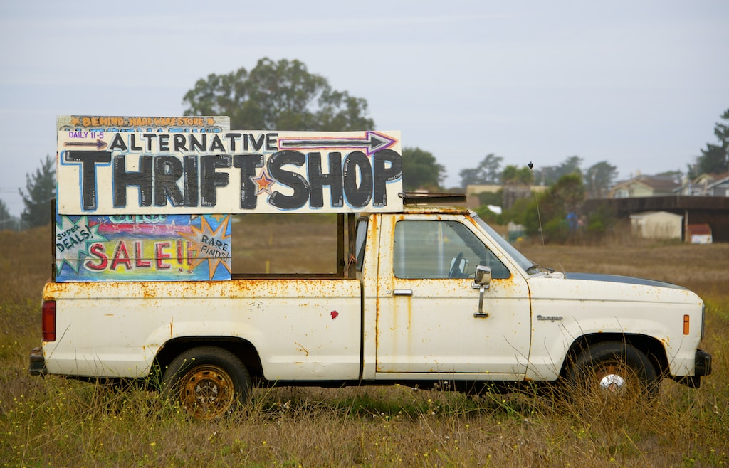 white single-cab truck with signage