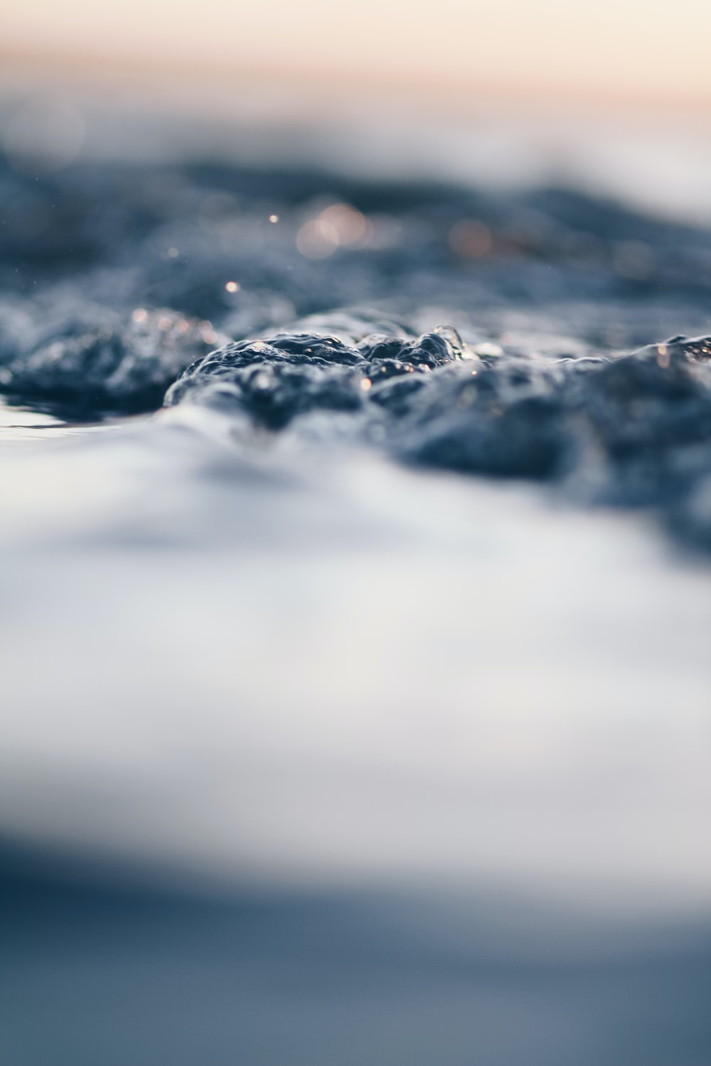 bokeh photography of body of water