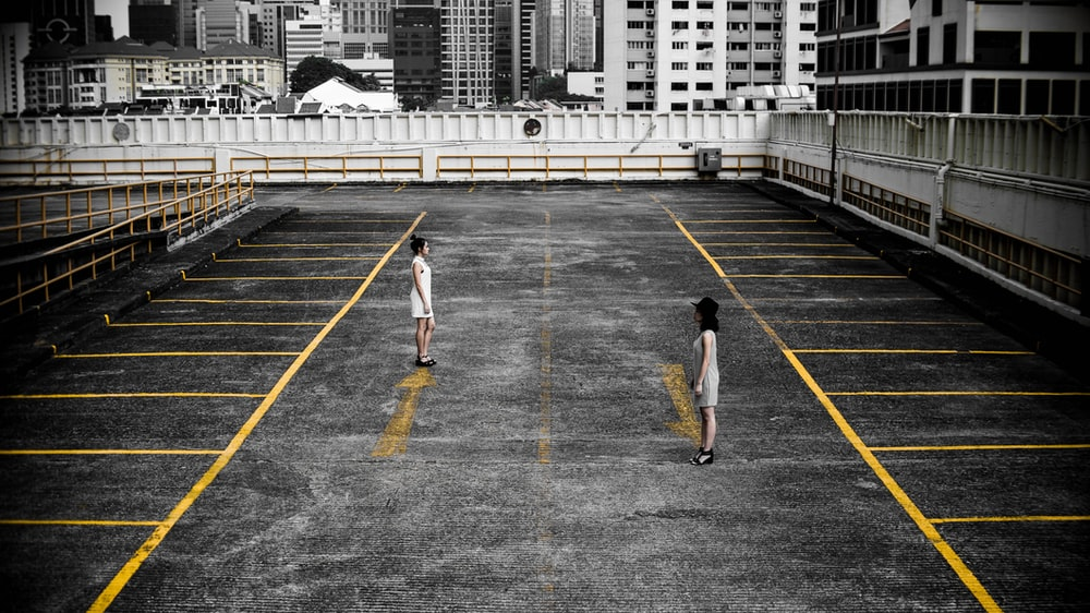 two woman in parking lot