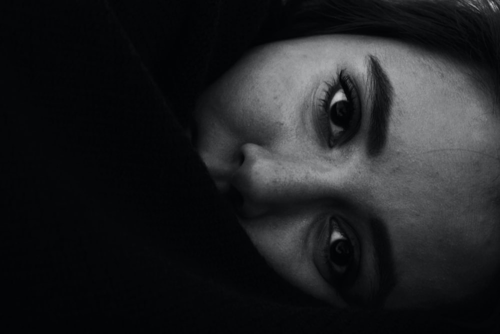 Black and white close up of horizontal female face in Tehran Province
