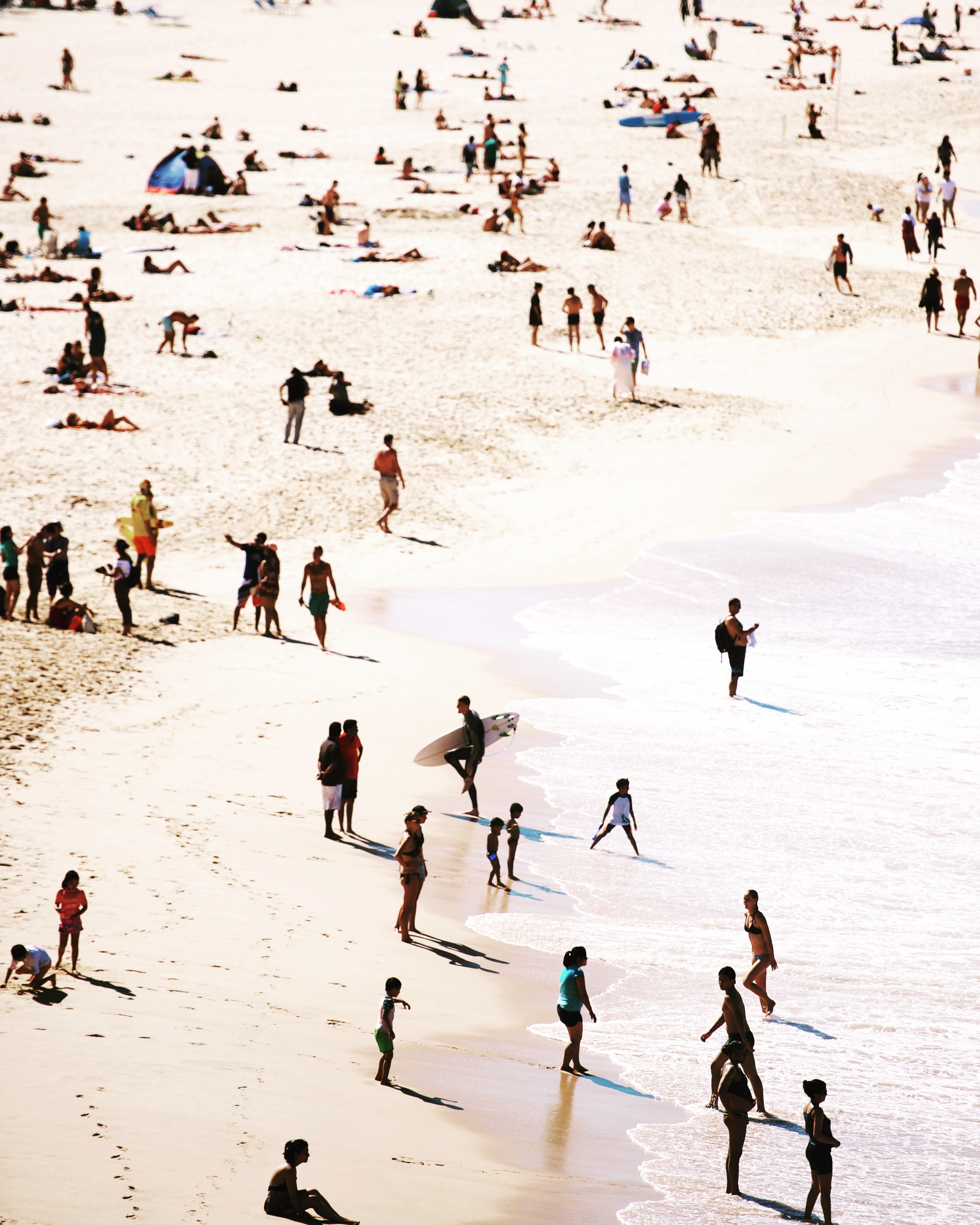 A high-angle shot of a crowded beach in the summertime