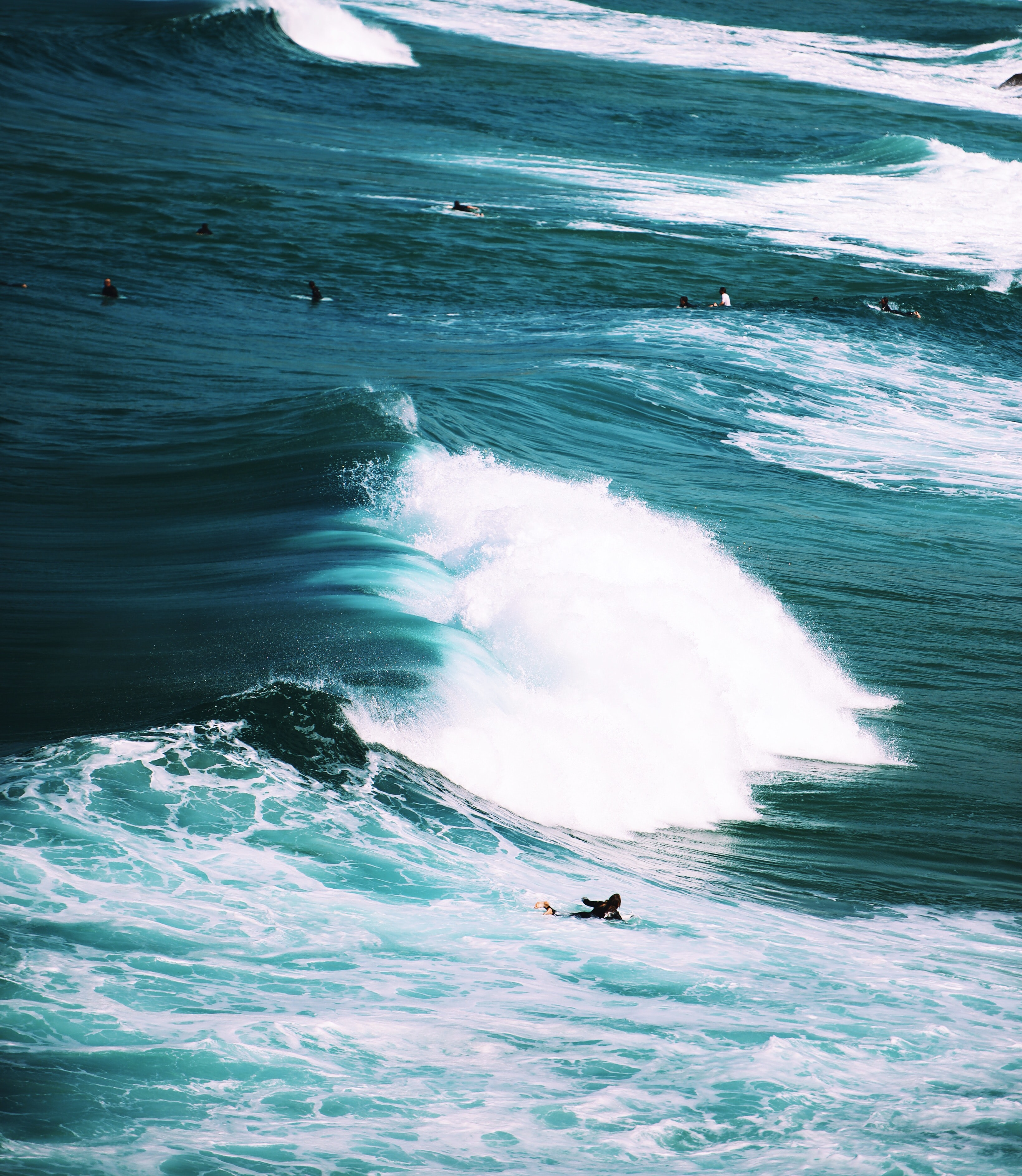 person on surfboard with ocean waves