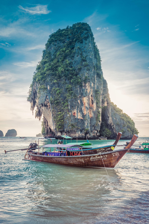 Boats by a rocky island