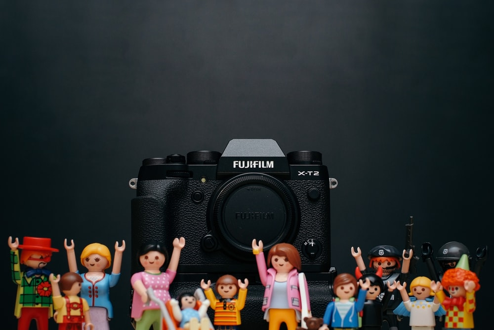 black Fujifilm camera body with minecraft toy lot