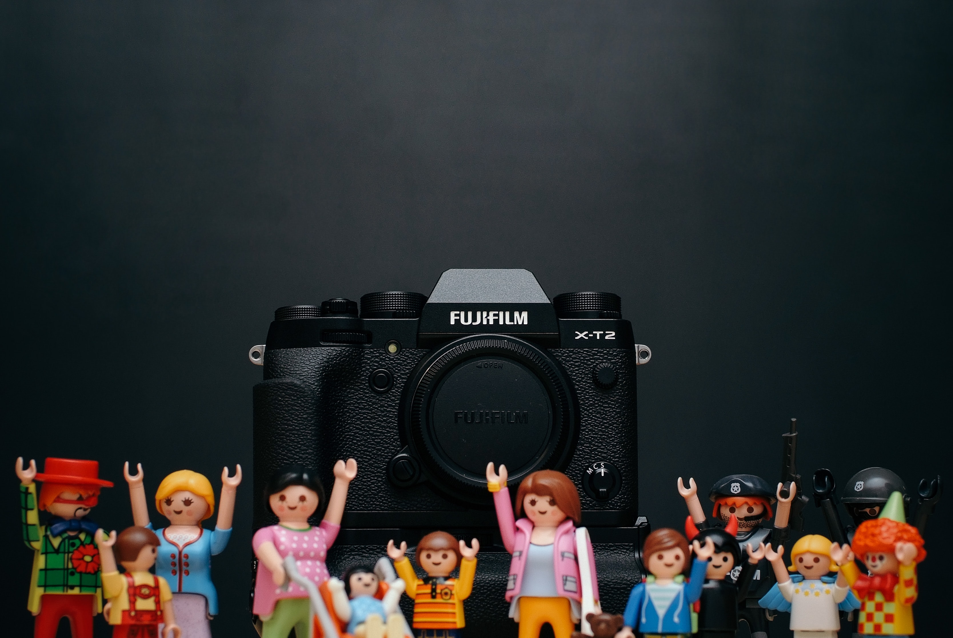 black Fujifilm camera body with minecraft toy lot