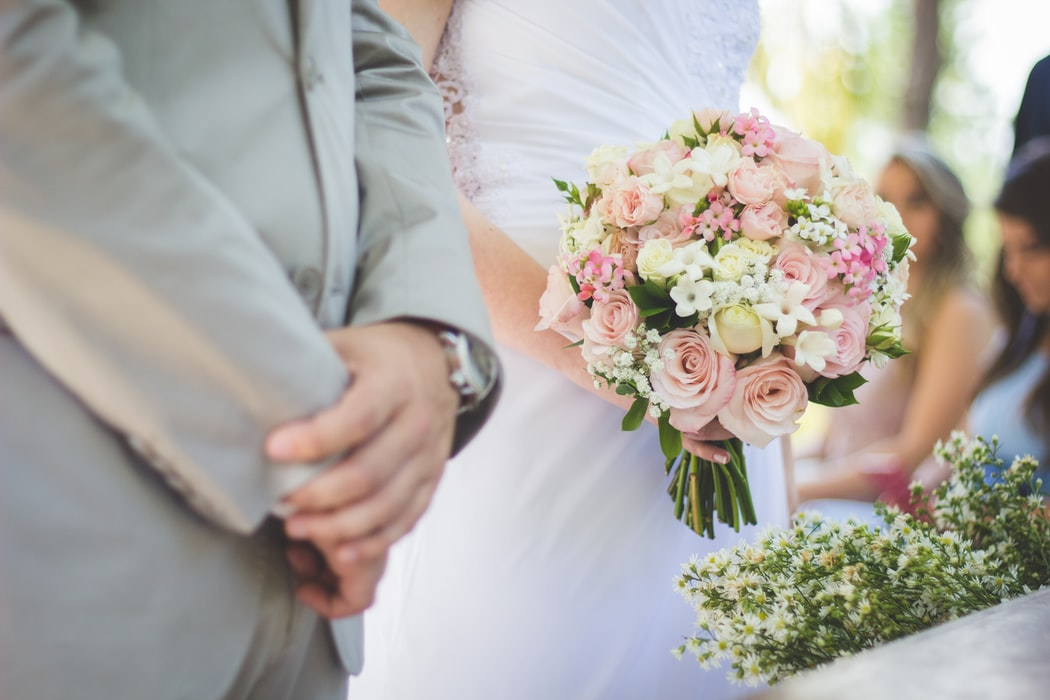 groom and bride with her floral wedding bouquet