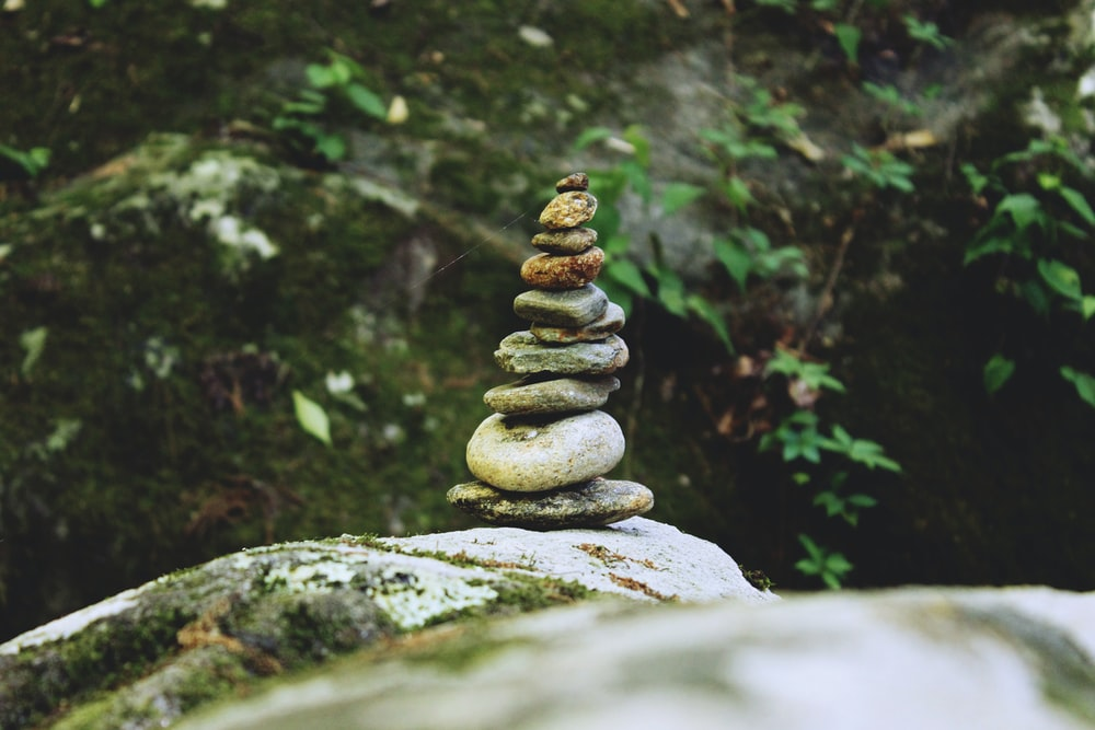 pile of stones selective focus photography