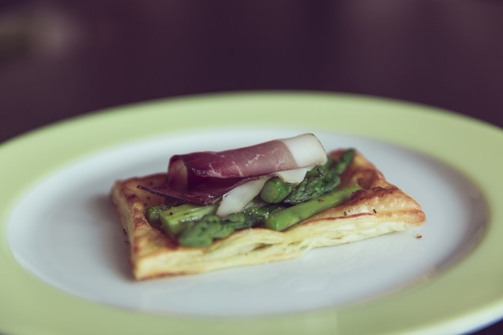 bacon, asparagus, and egg on plate