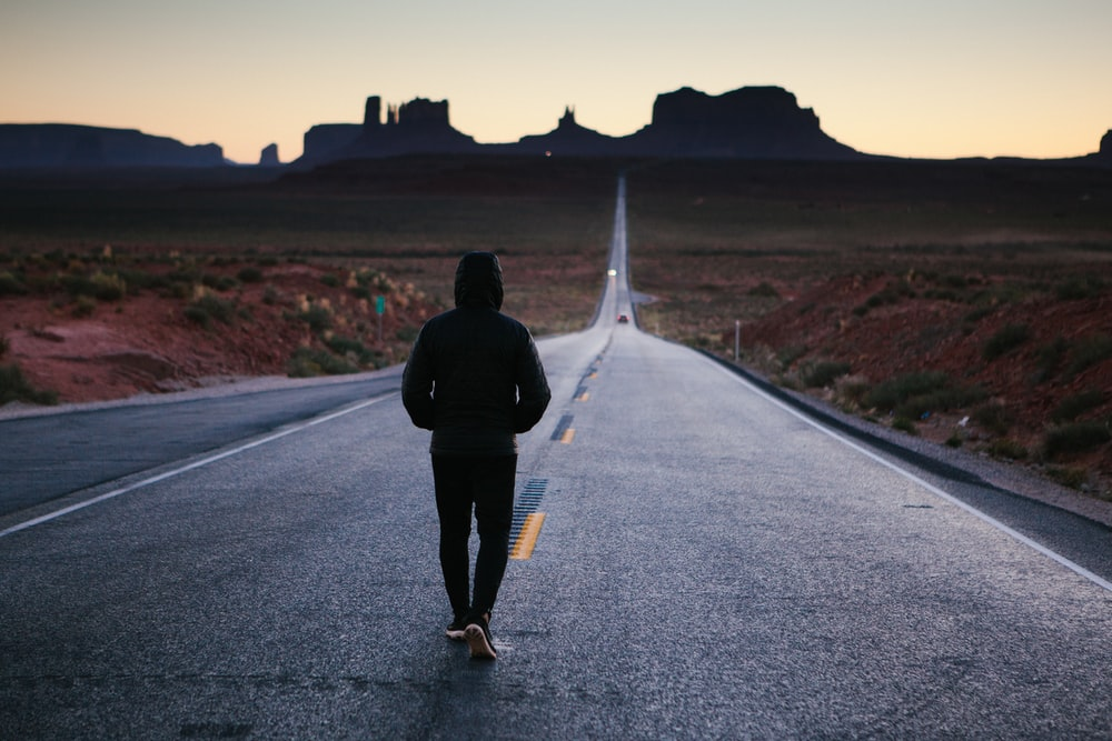 Person Walking In The Center Of Road
