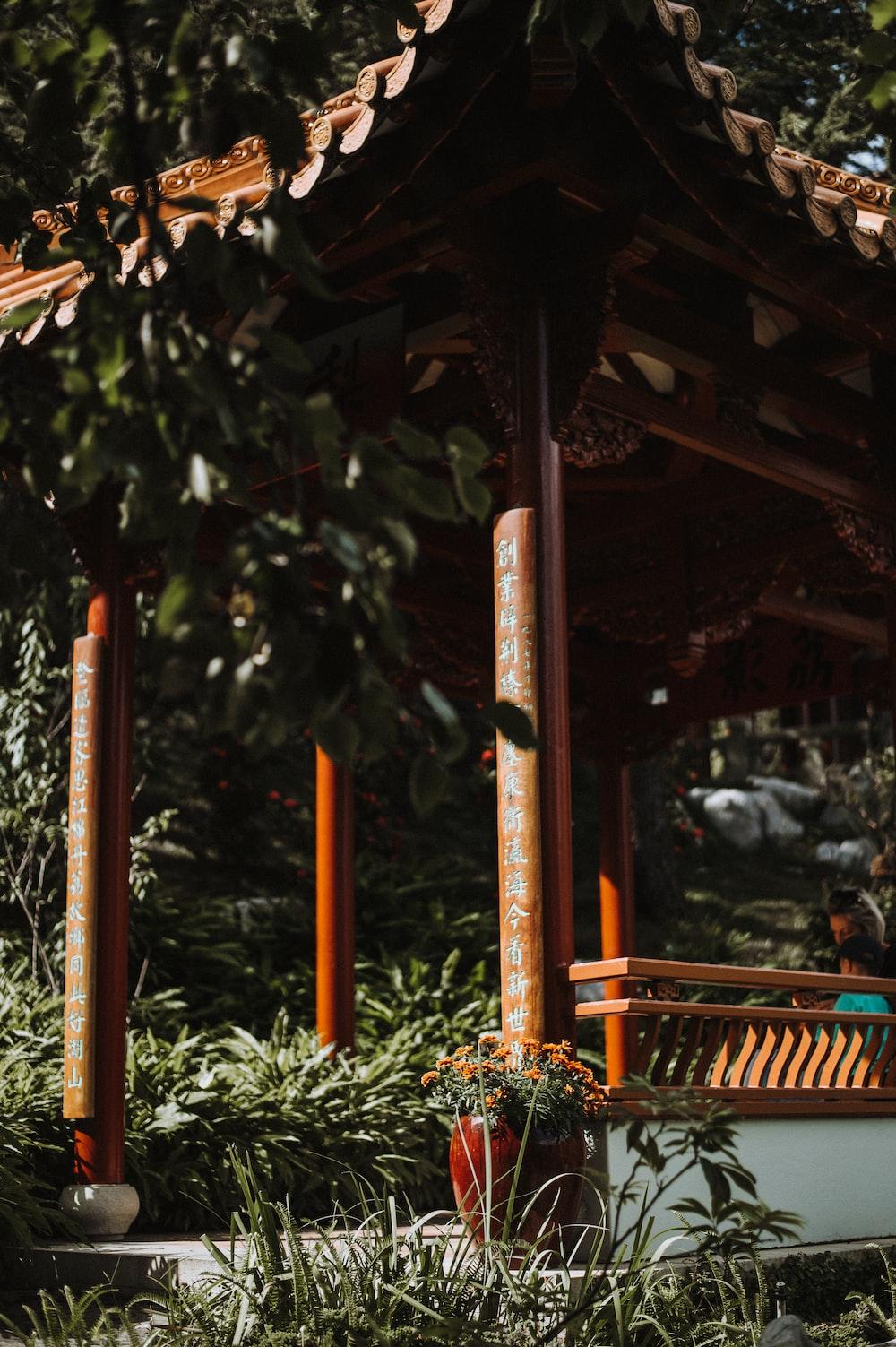 brown wooden pagoda selective focus photography