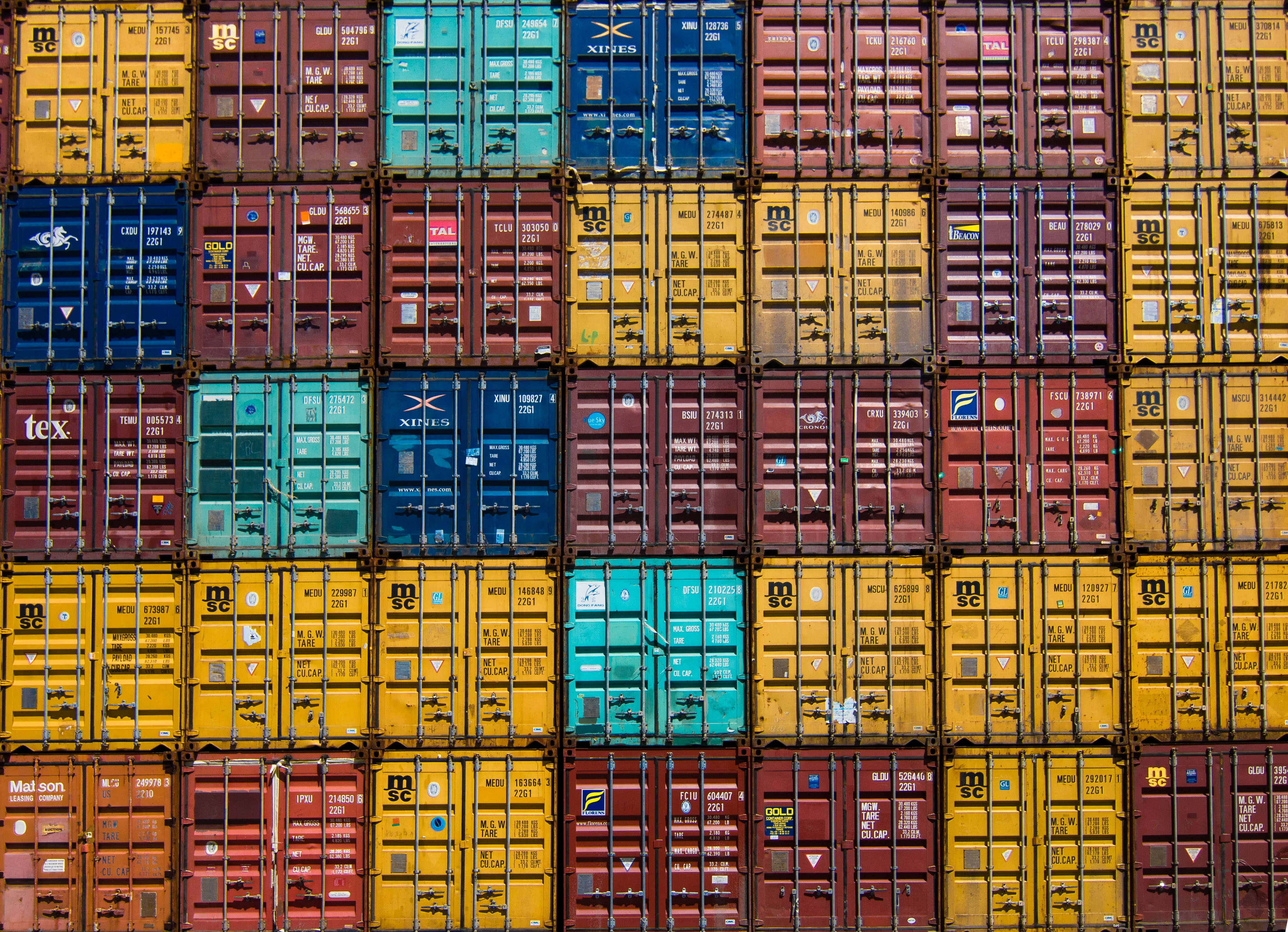 A stack of shipping containers forming a colorful pattern