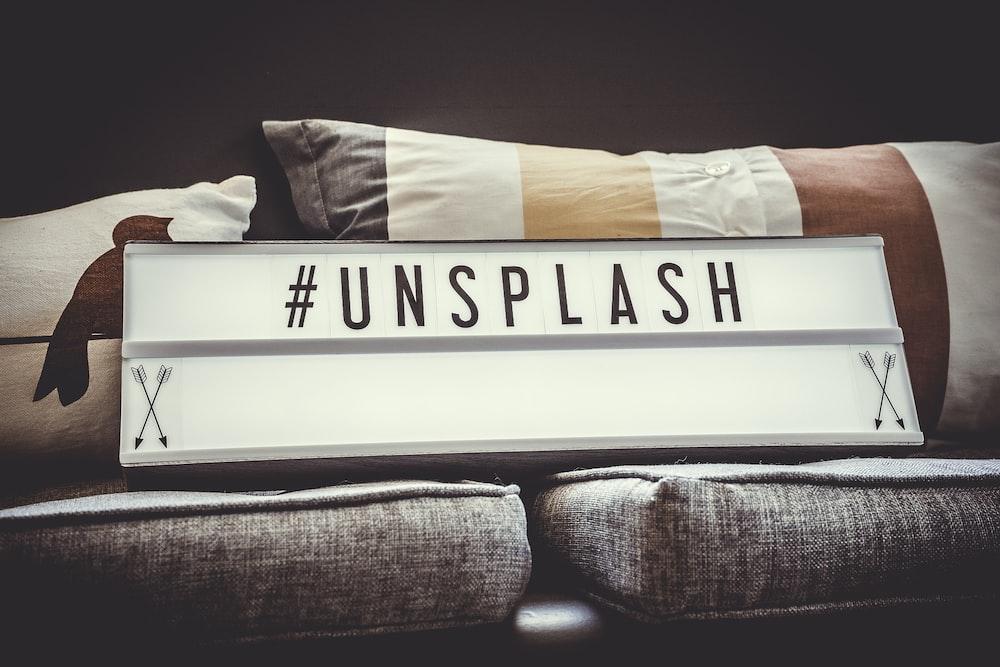 white and black unsplash signage