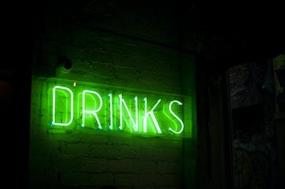 green drinks neon signage irish teams background