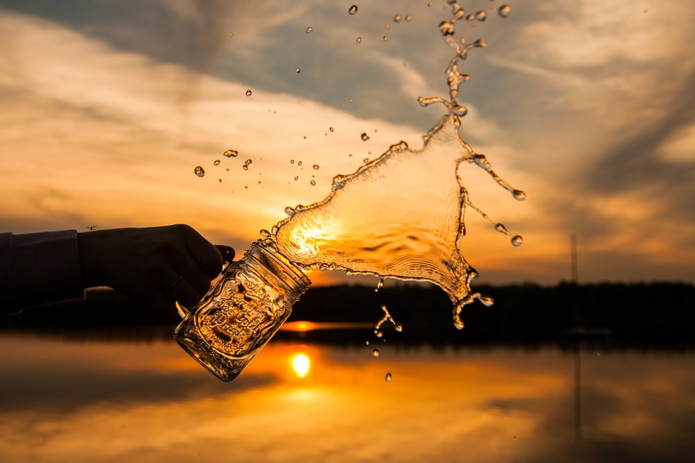 silhouette photo of splash of water