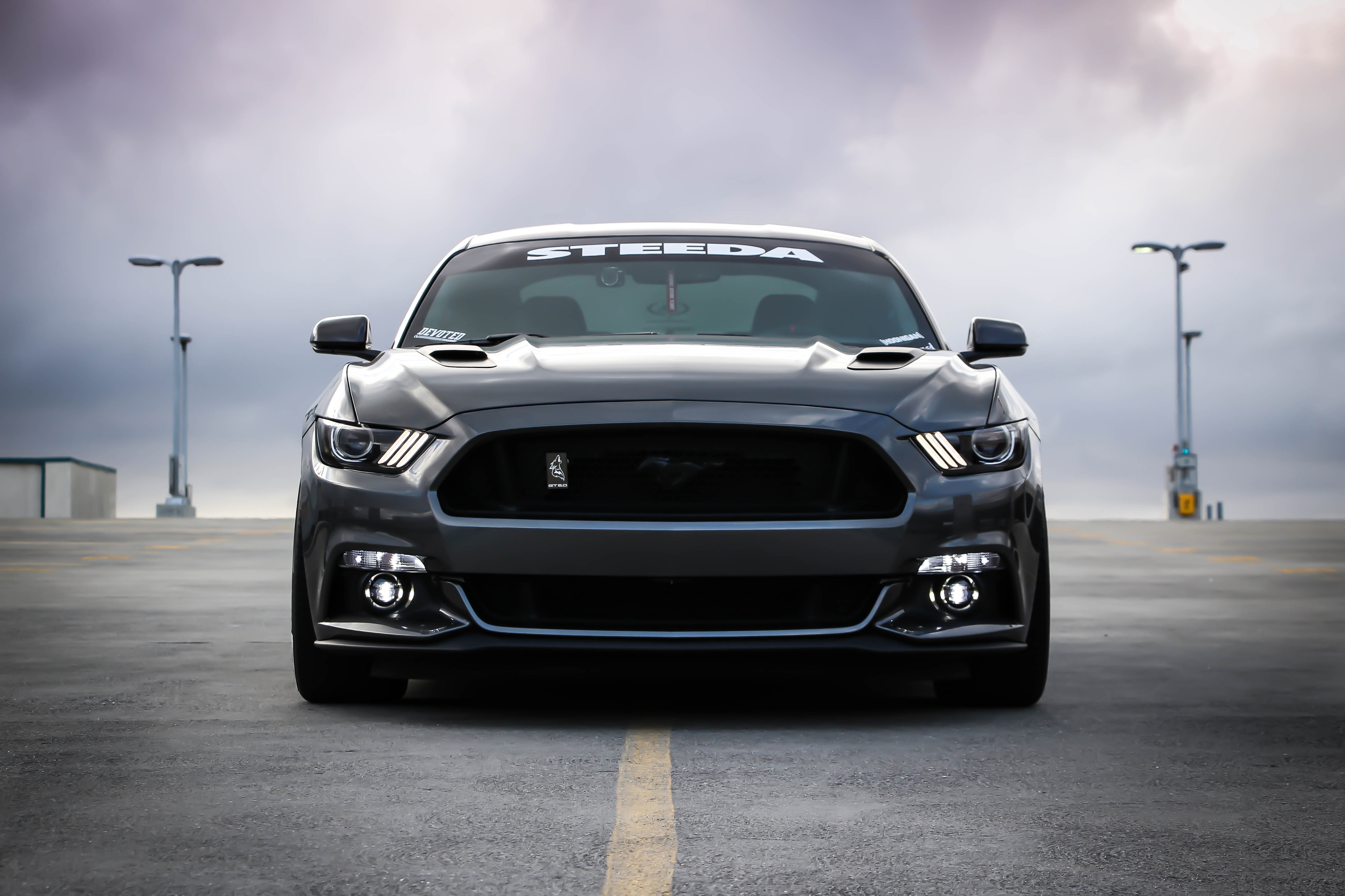 The front of a black 2016 Mustang GT
