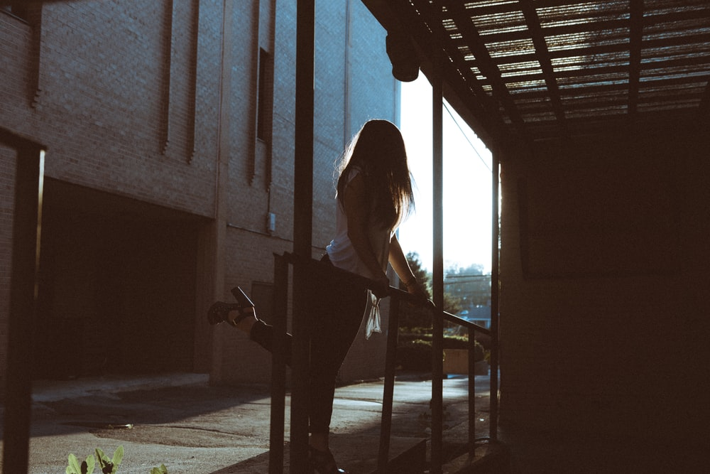 woman standing in front of metal rail