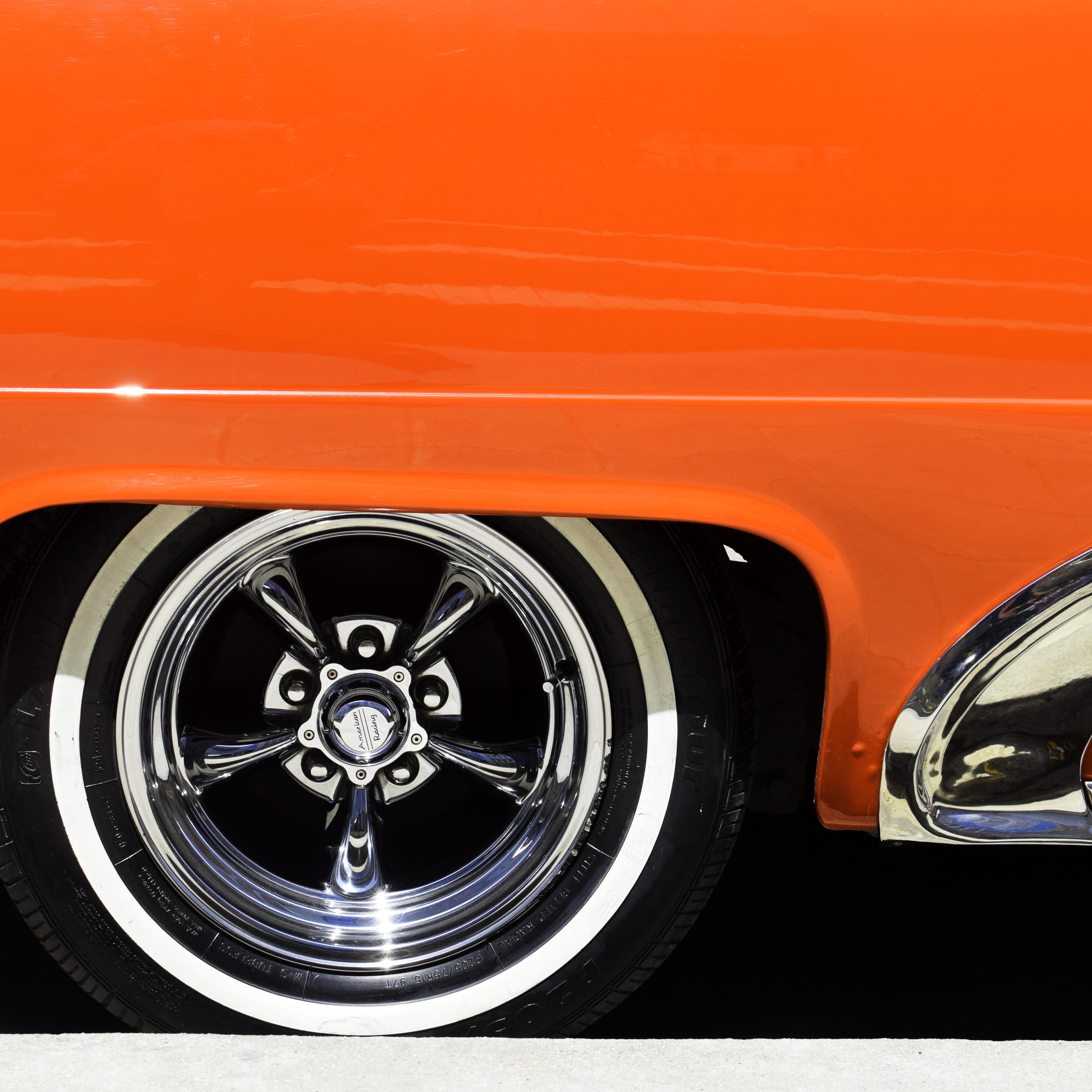 A classic tire on an orange sports car in Havana