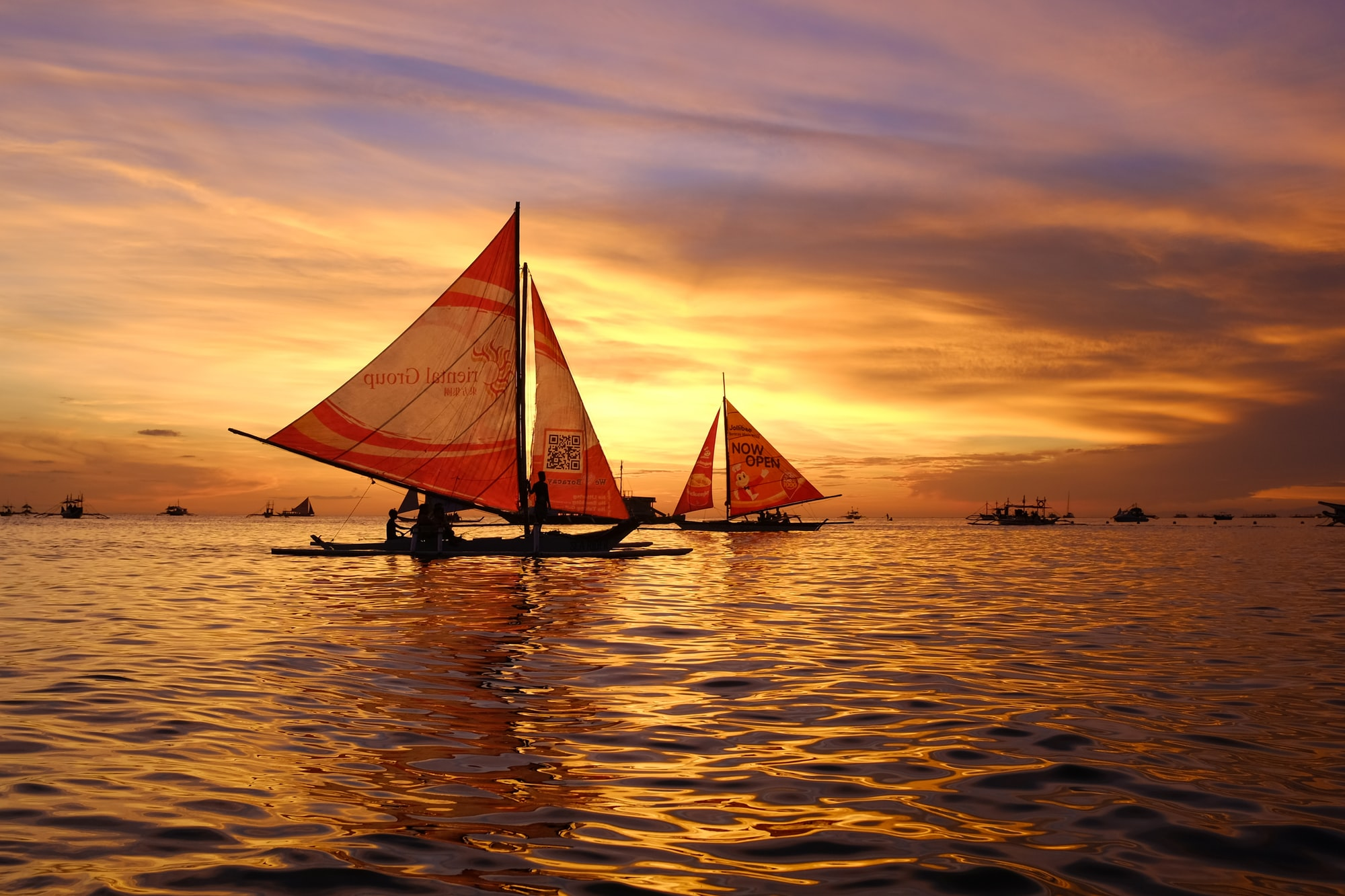 Sail boats and Sunset in Boracay Philippines