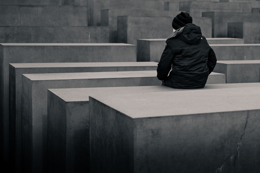 This kid was sitting in the middle of Berlins jewish memorial. It amazed me how the kid was surrounded by those monoliths/blocks.