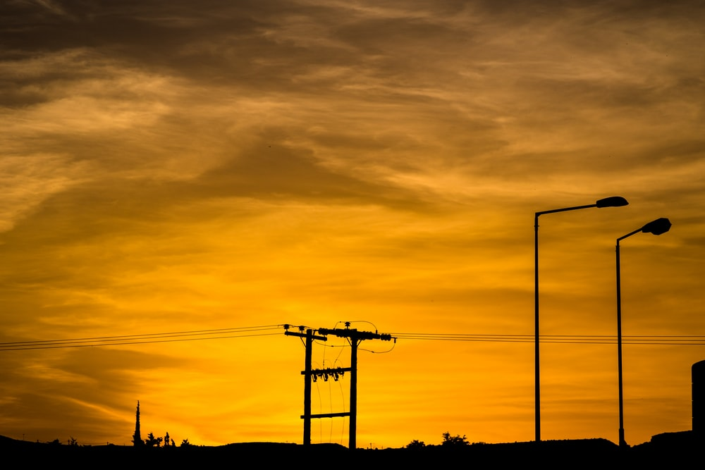 silhouette of communication tower during sunset