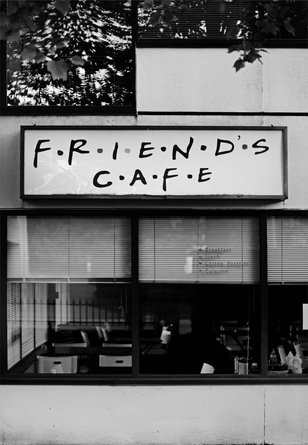 gray scale photo of Friends Cafe store