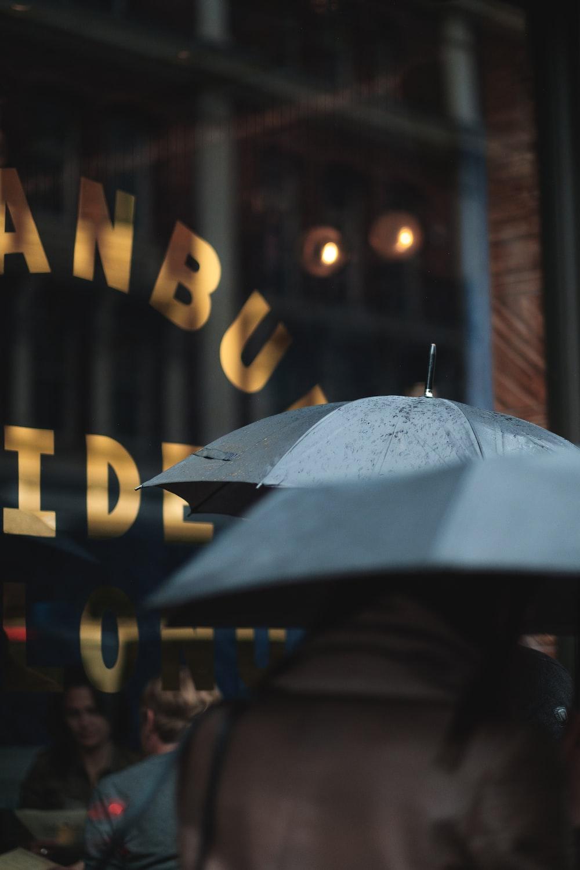 man on blue umbrella