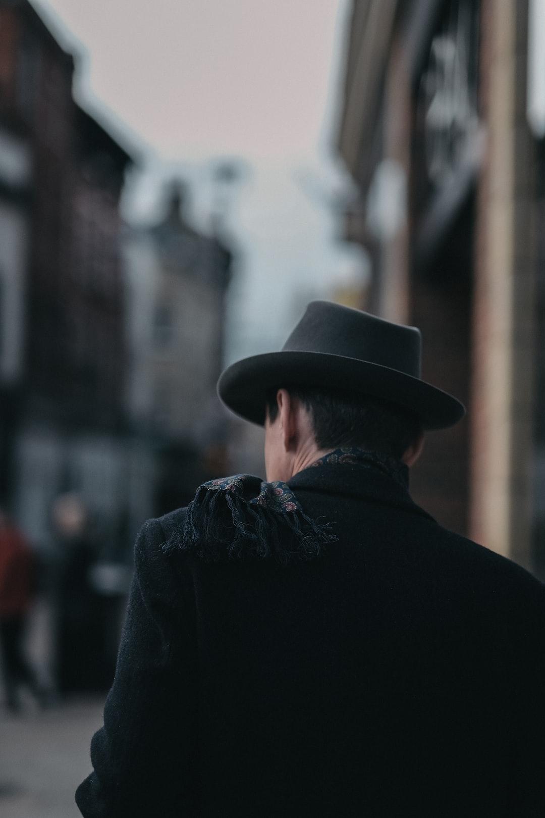 Man in hat facing away