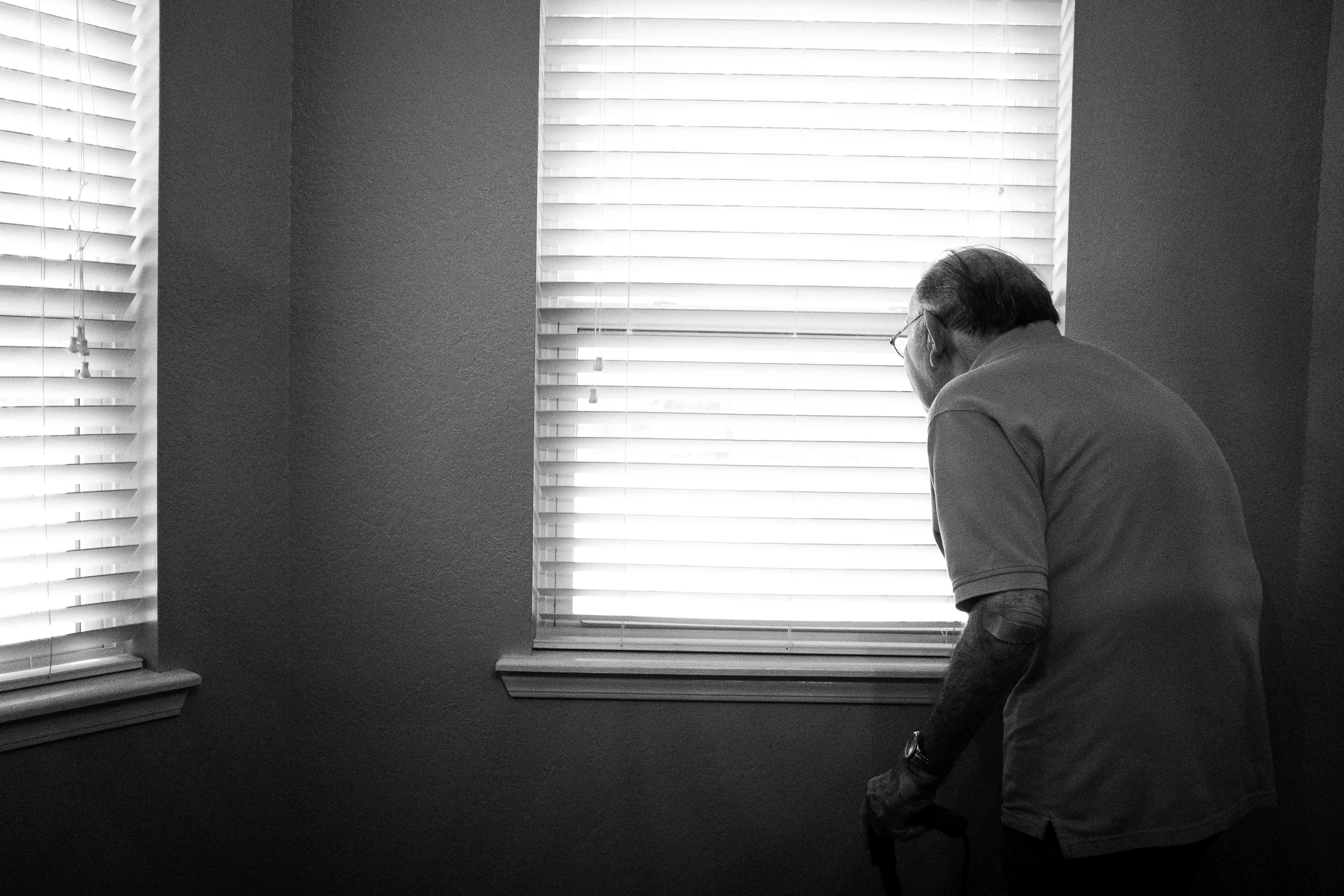 man standing inside white painted room
