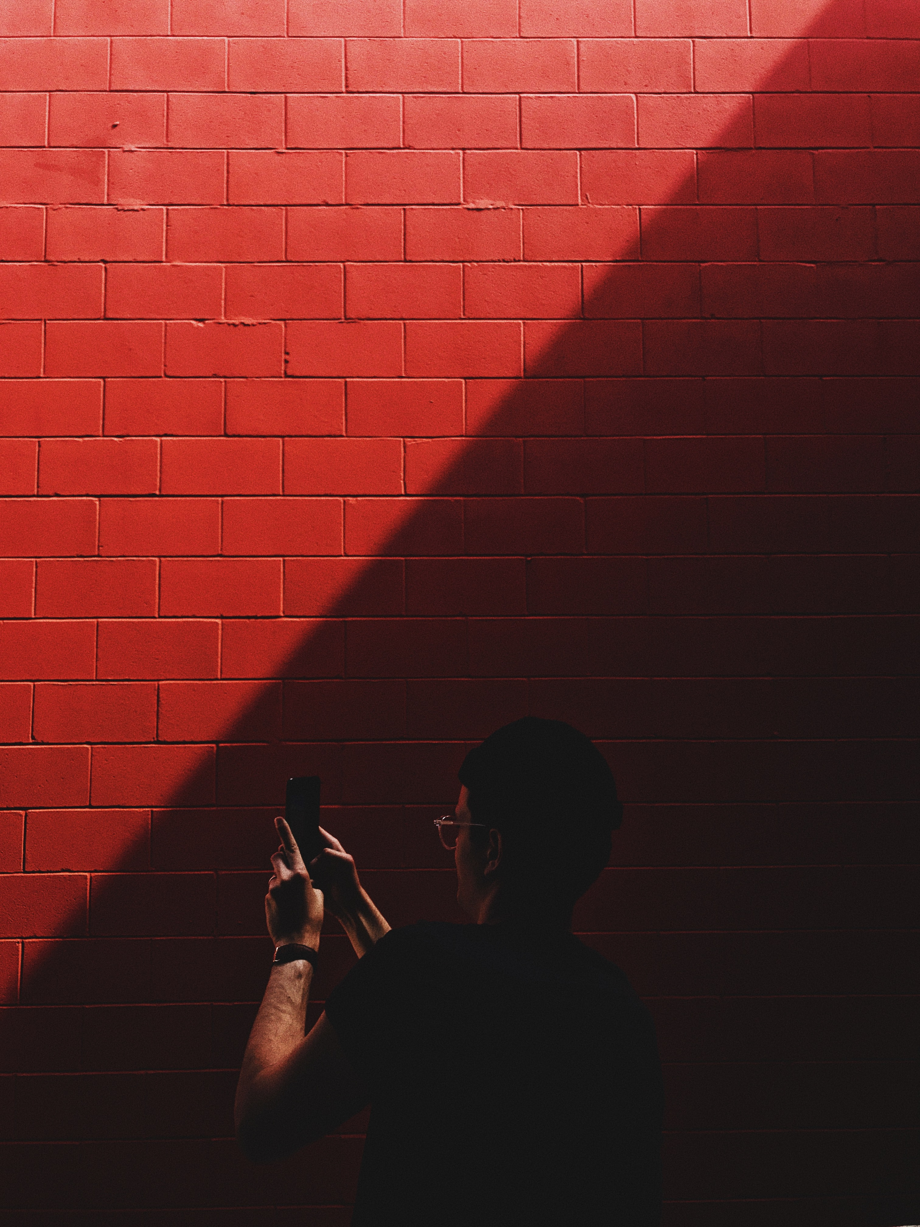 person capturing red brick