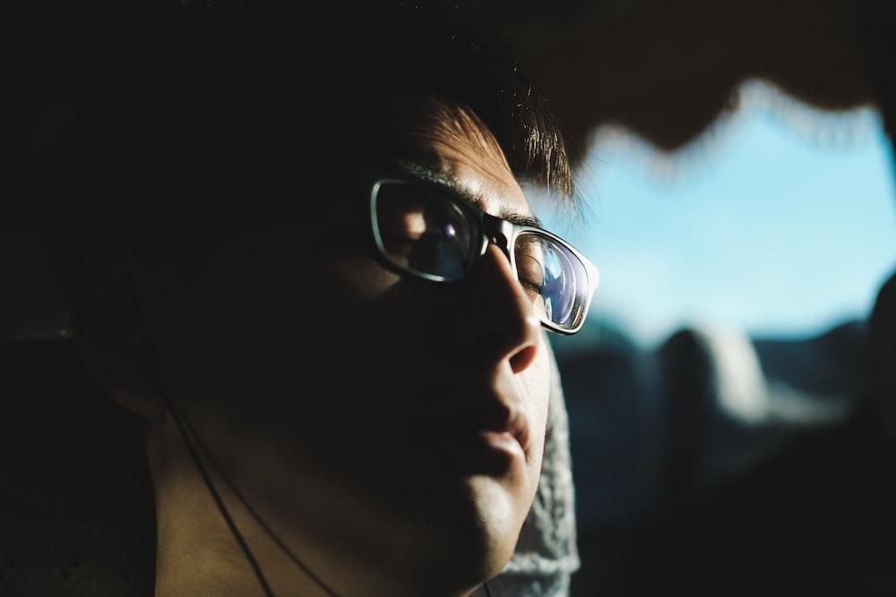 man eyes closed wearing eyeglasses
