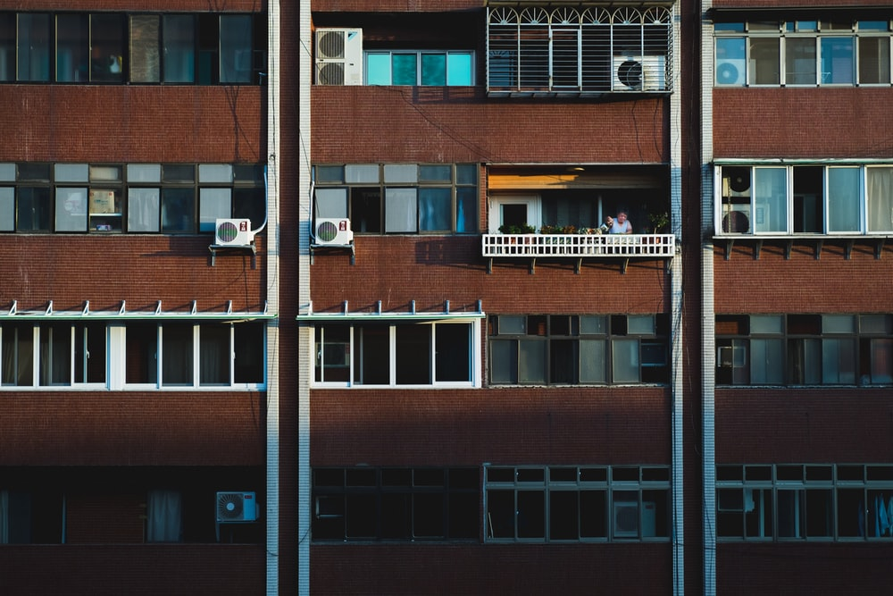 person at the balcony of a building during day