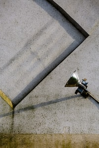 gray stainless steel lamp on gray concrete pavement