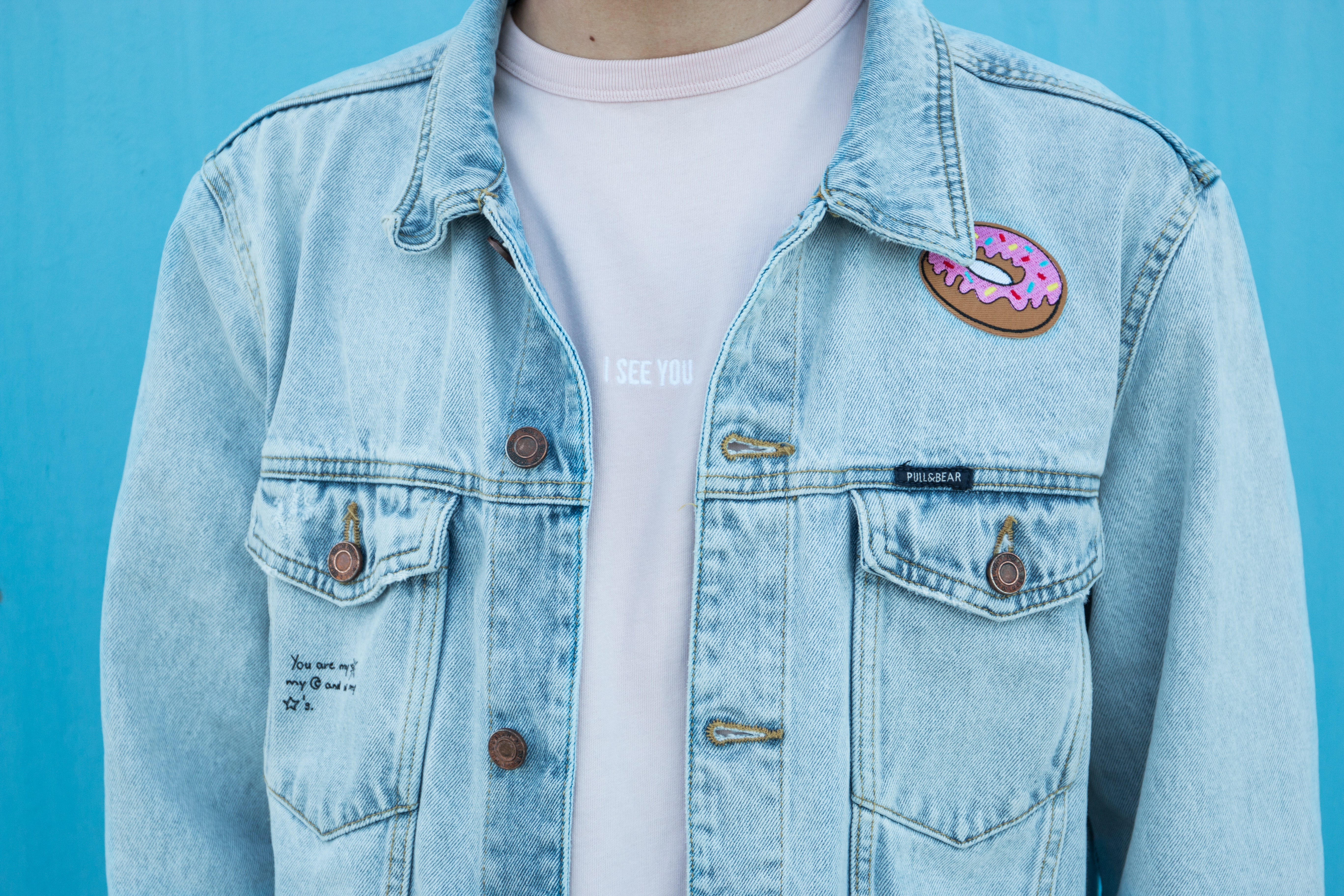 close shot of person denim top