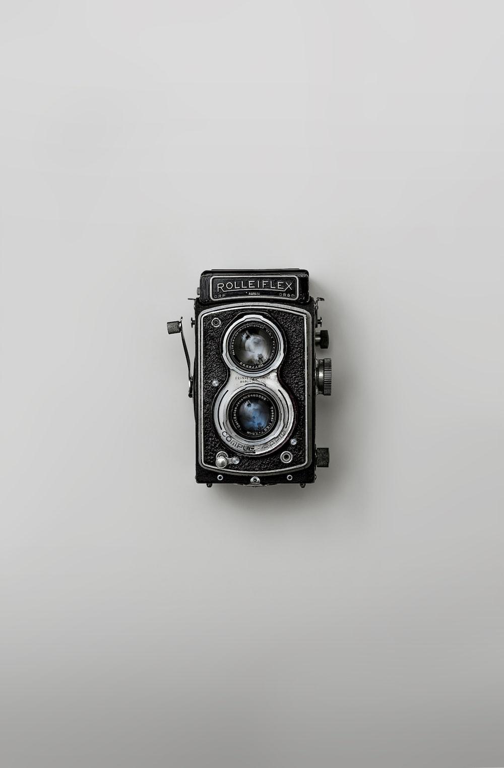 black and silver vintage camera