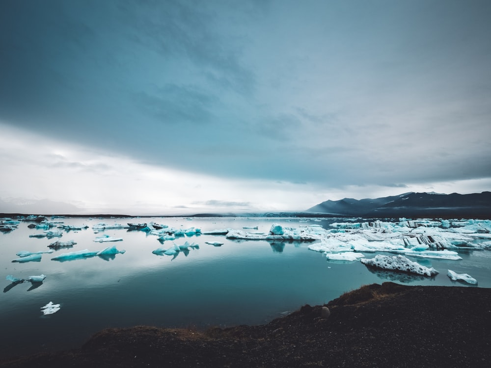 ice bergs on body of water