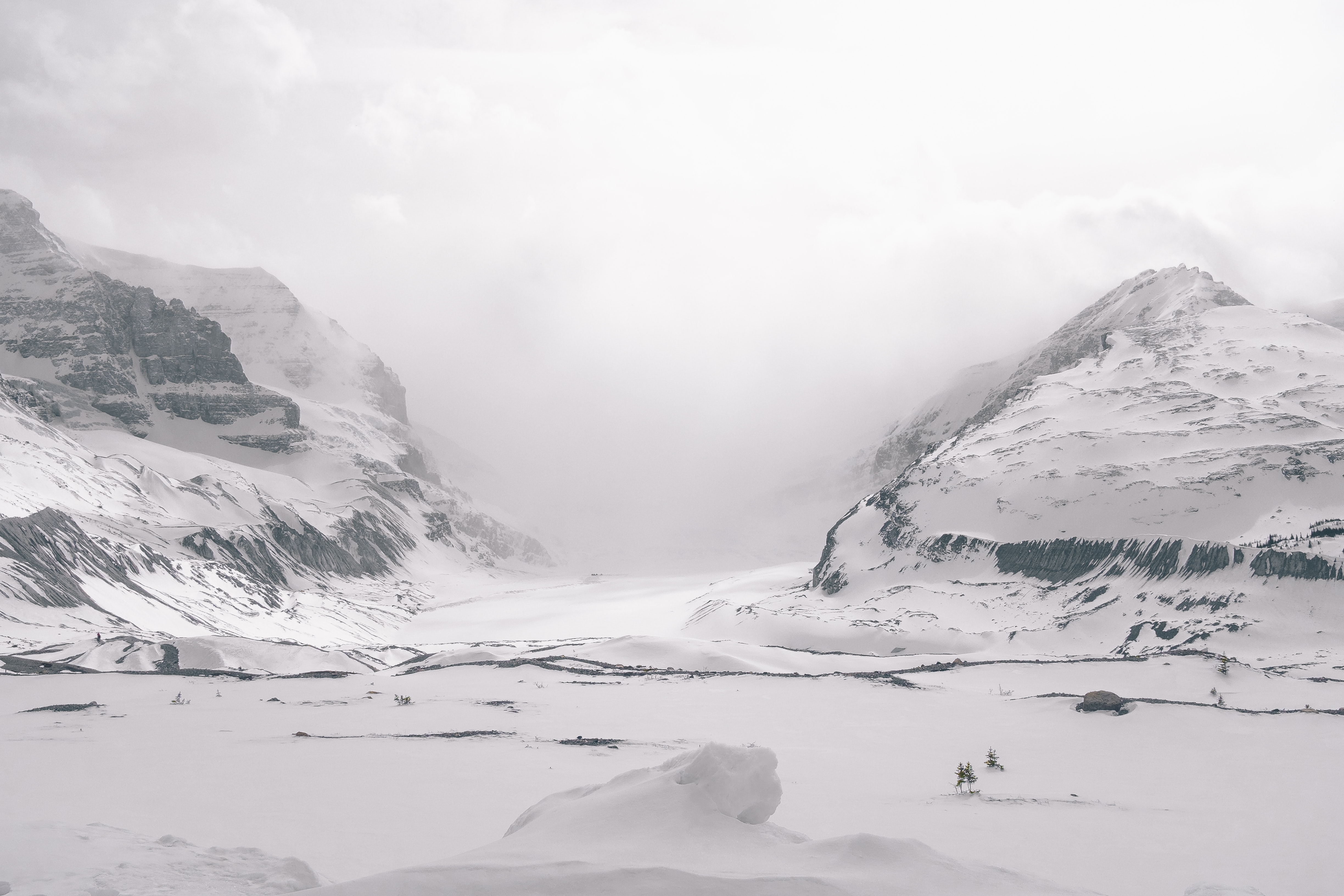 Snowy mountains and glacier covered in fog
