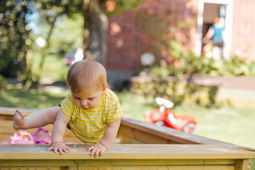baby trying to get out of his crib