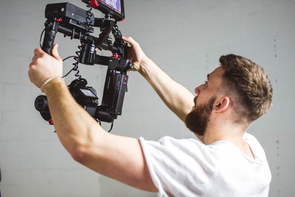 man holding camera with stabilizer