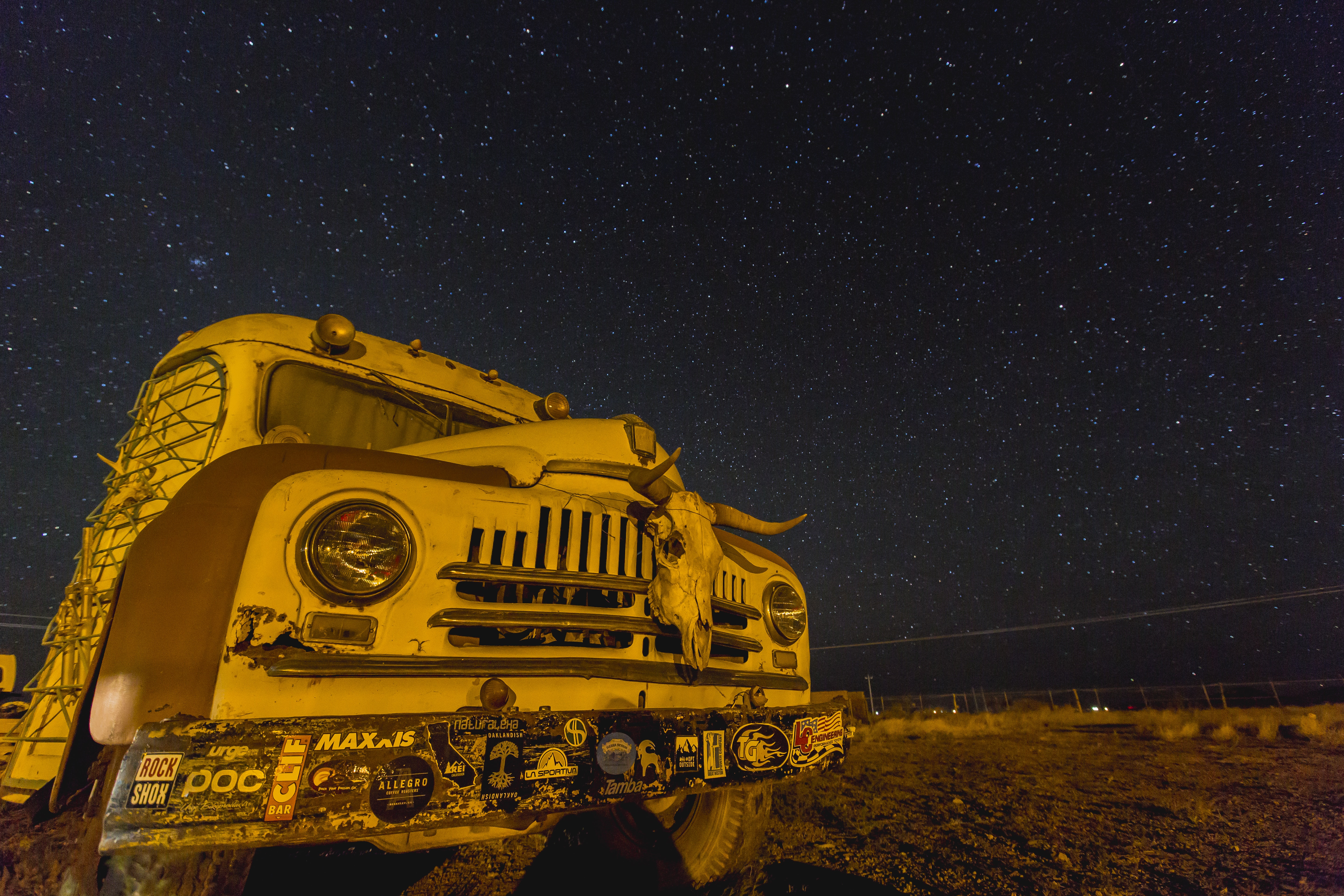 photo of white and brown bus with stars during nighttime
