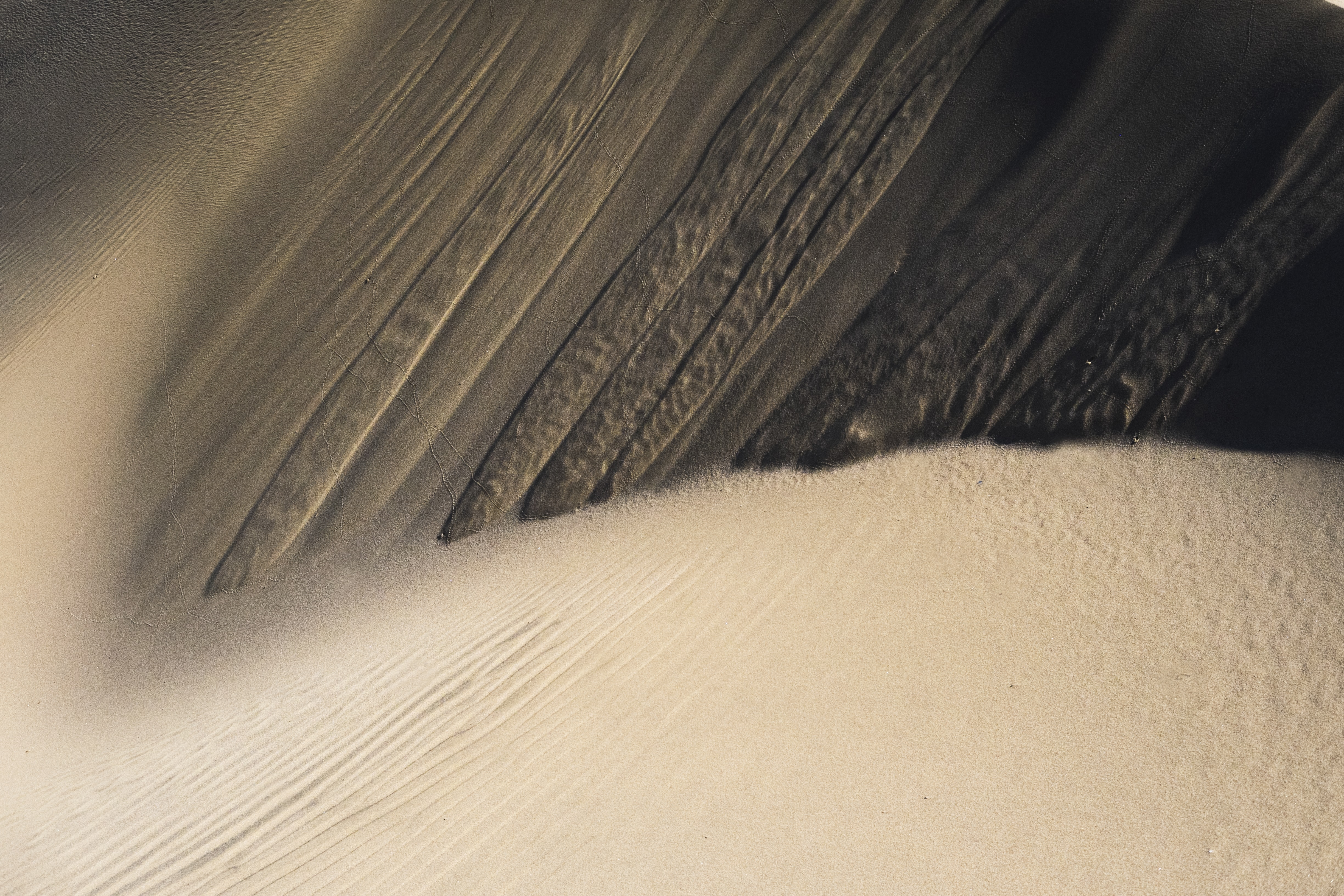 Macro shot of wavy texture and wind patterns in the sand