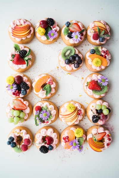 Donuts halo'ed with fruits and flowers. Whatever could be better?