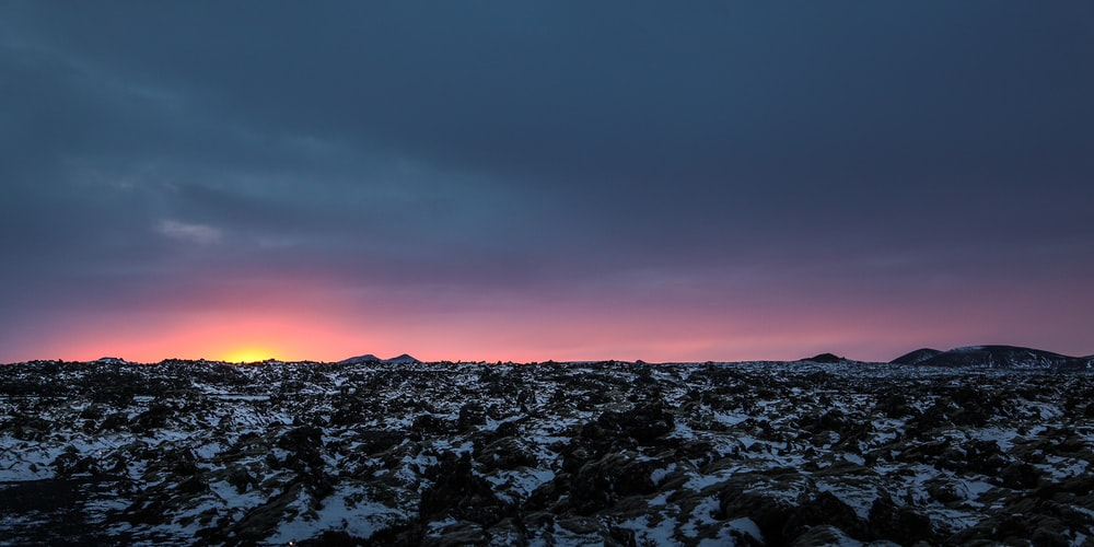 snow covered field with sunrise