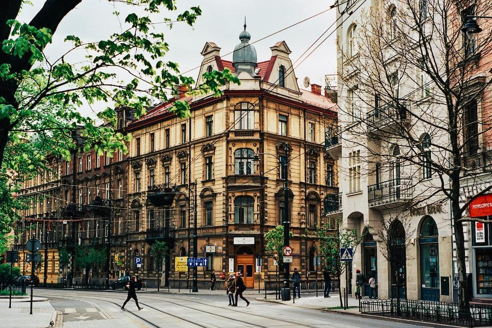 people walking near beige building