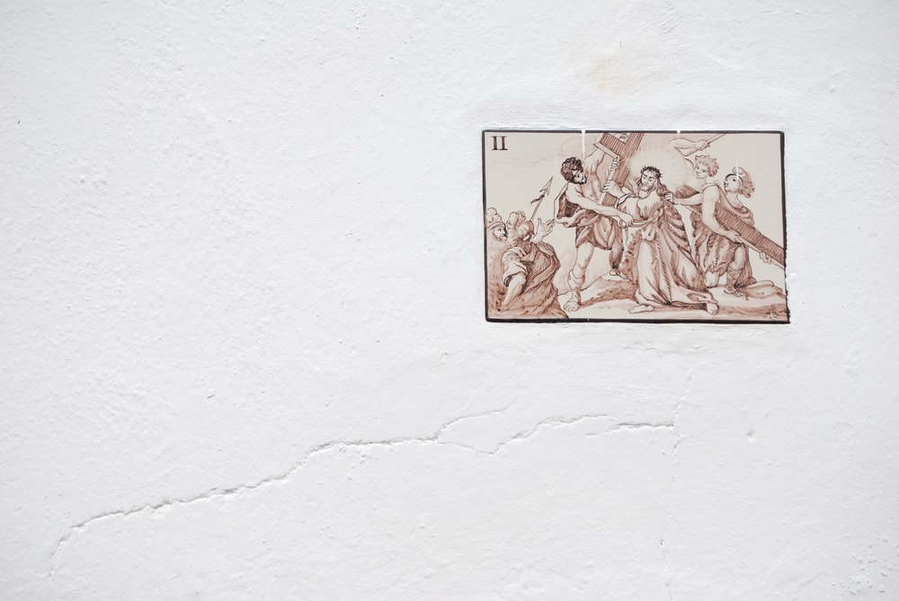 Jesus carrying cross painting on wall