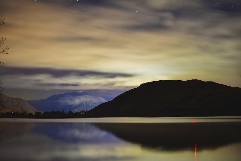 landscape photography of mountain under gloomy sky