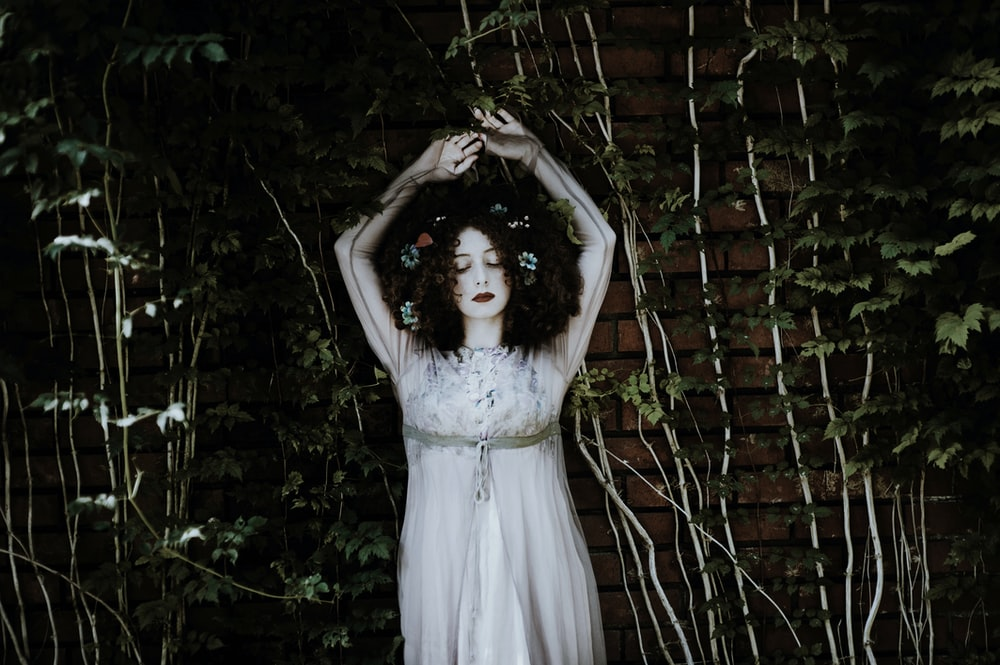 woman wearing white dress on garden