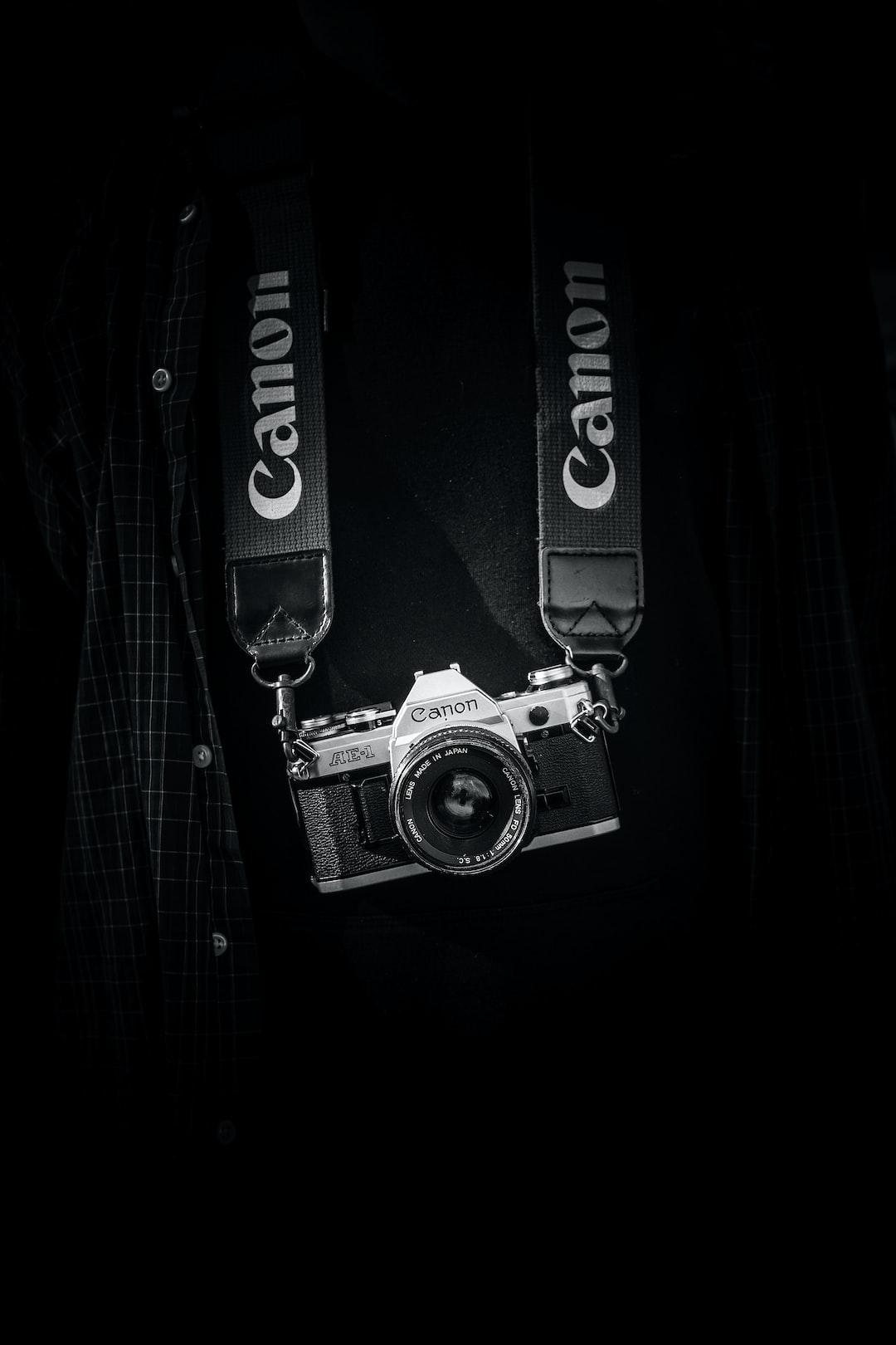 monochrome canon camera hangs