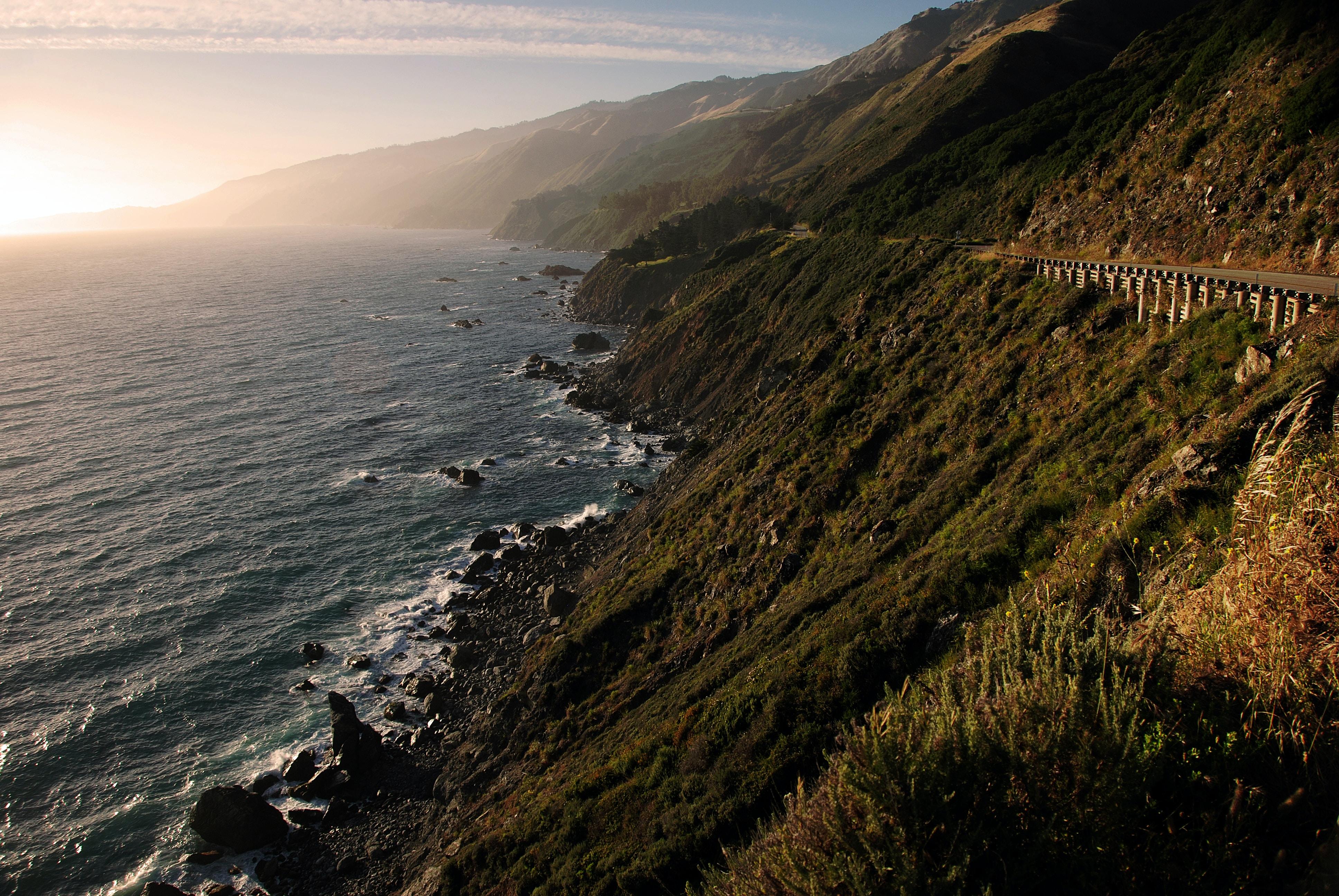 road near seashore during daytime