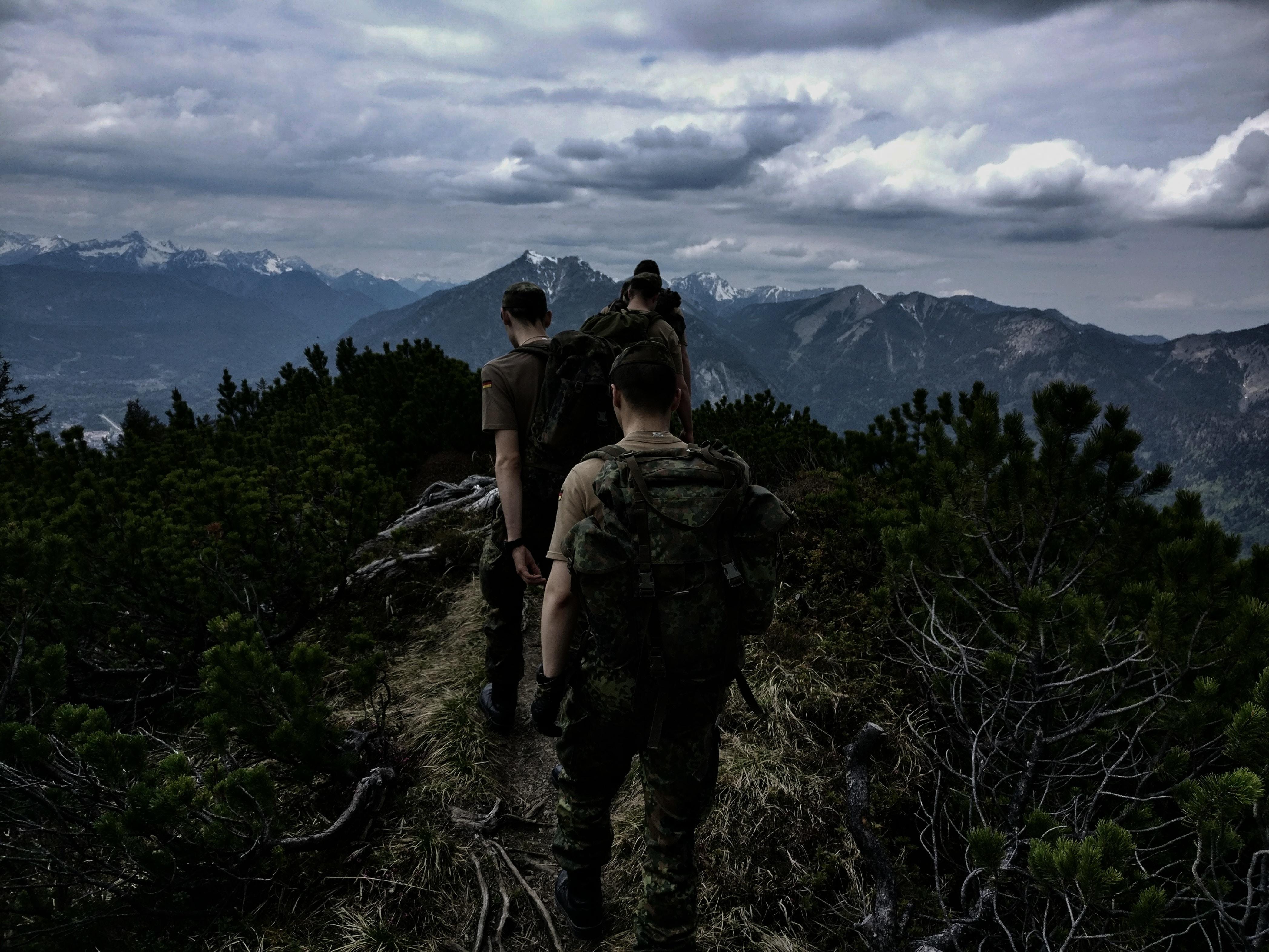 men walking on top of mountain