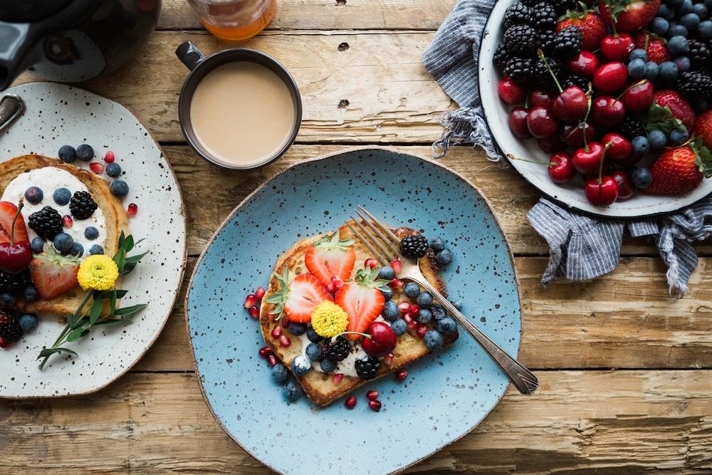 fruit sandwich on a blue ceramic plate